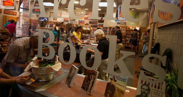 a view of a bookstore sales area through a glass window