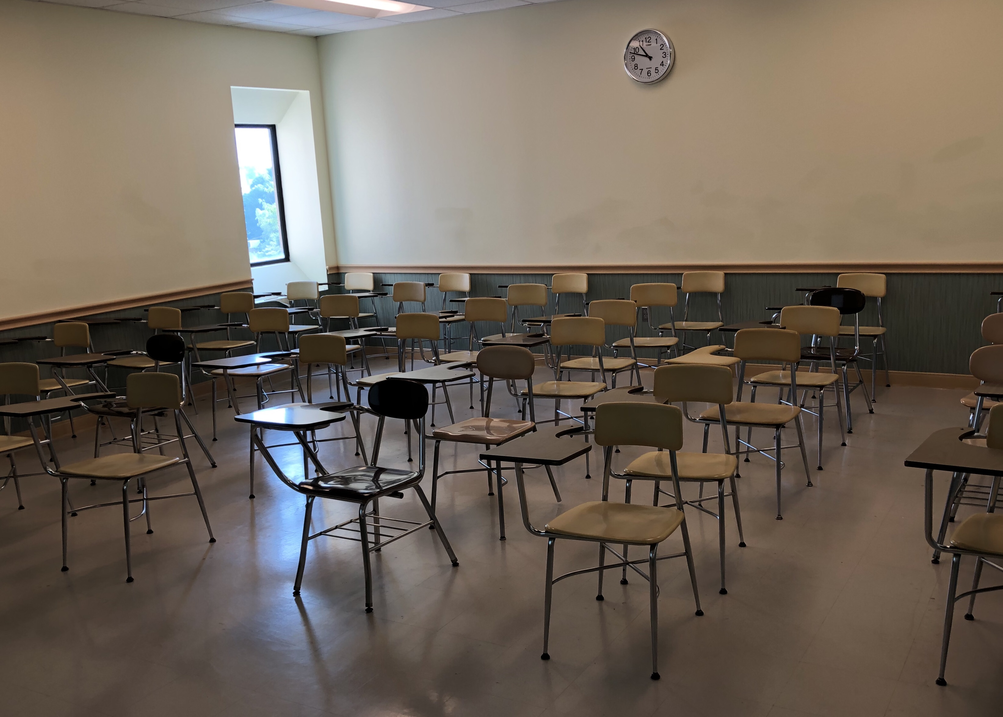 Desks in an empty classroom