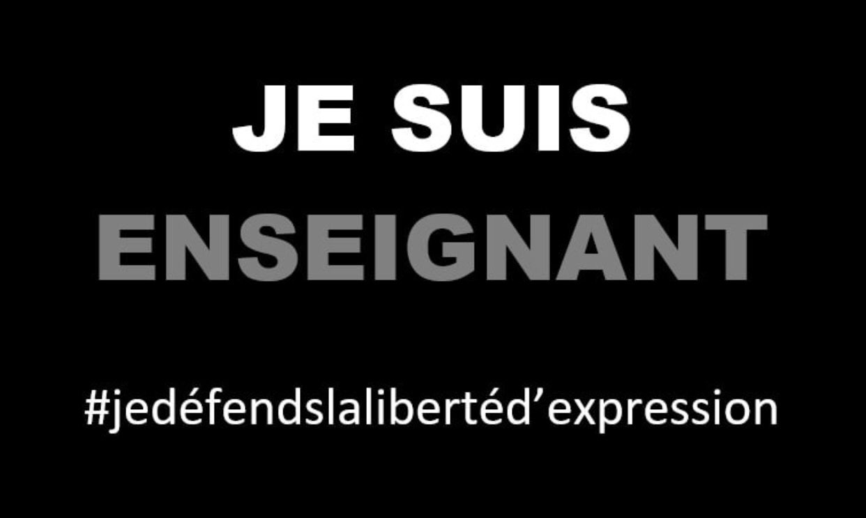 "A black image with white and gray text, saying ""je suis enseignant."""